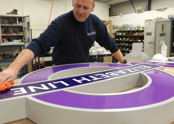 Elizabeth line signage in production at aj wells sons 294855